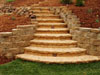 Here's another example of a custom-built stairway, this one has rounded steps and is built from cut stone.